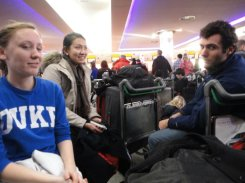 Here we are at Heathrow Airport - putting on our best smiles. How long will this last?