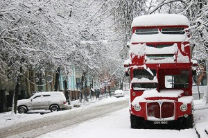 London double decker bus covered by snow as snowstorm hits Europe