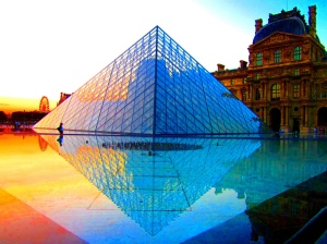 The Louvre Pyramid at sunset Paris