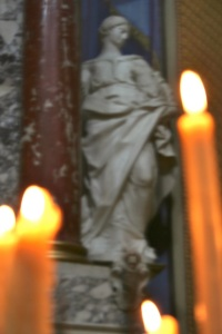 Candles and ancient statue on Croatian island